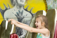 Excited little girl enjoying a ride at the funfair Royalty Free Stock Image