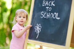 Excited little girl going to a preschool Stock Photos