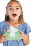 Excited little girl holding a wrapped gift Stock Photography
