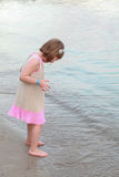An excited little girl looked at the small waves Royalty Free Stock Images