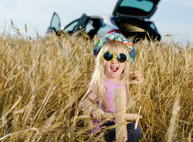 Excited little girl playing with a toy plane Stock Photography