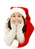 Excited little girl in red Santa hat Royalty Free Stock Images