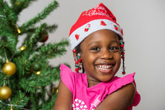 Excited little girl in santa hat Royalty Free Stock Images