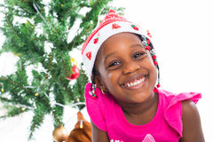 Excited little girl in santa hat Royalty Free Stock Photo