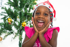Excited little girl in santa hat Stock Photography