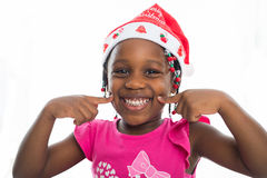 Excited little girl in santa hat Royalty Free Stock Photography