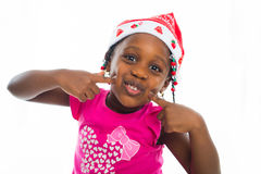 Excited little girl in santa hat Stock Photo