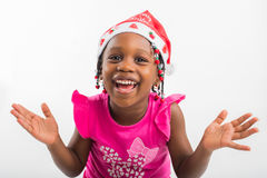 Excited little girl in santa hat Stock Image