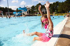 Excited little girl screaming with joy in aquapark Royalty Free Stock Image