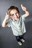 Excited little red hair child with freckles counting to one or saying OK Royalty Free Stock Images