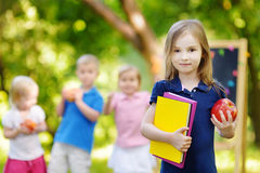 Excited little schoolgirl going back to school Royalty Free Stock Photography
