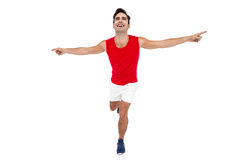 Excited male athlete with arms outstretched Royalty Free Stock Photography