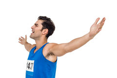 Excited male athlete with arms outstretched Stock Photography