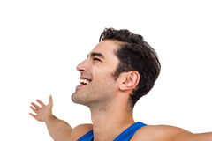 Excited male athlete with arms outstretched Stock Images