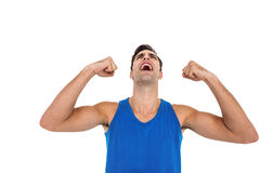 Excited male athlete posing after victory Stock Photography