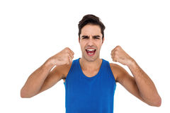 Excited male athlete posing after victory Royalty Free Stock Photography