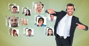 Excited male customer care representative gesturing by flying business portraits Royalty Free Stock Photo