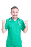 Excited male doctor rejoicing his success Royalty Free Stock Images