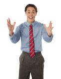 Excited male executive posing Stock Photography