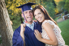 Excited Male Graduate in Cap and Gown and Girl Stock Images