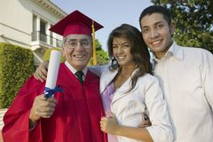Excited Male Graduate With Family Royalty Free Stock Photo