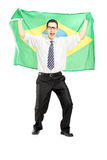 Excited male holding a brazilian flag Stock Photo