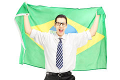 Excited male holding a brazilian flag Royalty Free Stock Photos