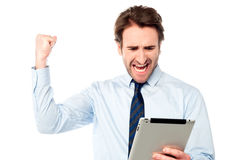 Excited male manager rejoicing on his victory Stock Images