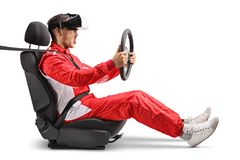 Excited male racer in a car wheel holding a steering and wearing VR headset. Isolated on white background royalty free stock images