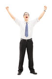 Excited male with raised hands gesturing happiness. Full length portrait of an excited male with raised hands gesturing happiness isolated on white background Stock Image