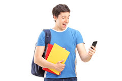 Excited male student looking at his phone Stock Photo