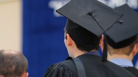 Excited male student waiting for his turn to receive higher education diploma. Stock footage stock video footage