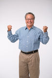 Excited man. Excited Asian mature man celebrating success,  on white Royalty Free Stock Photo