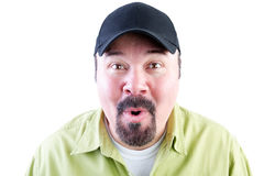 Excited man in baseball cap on white background Stock Photos