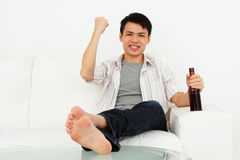 Excited man with beer Royalty Free Stock Photography