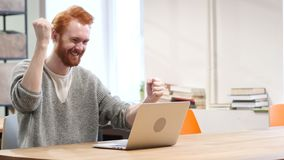 Excited Man Celebrating Success, Working on Laptop stock footage