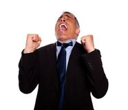 Excited man celebrating a victory Royalty Free Stock Photos