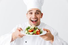 Excited man chef cook wearing uniform stock photo