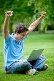 Excited man with computer Stock Photo