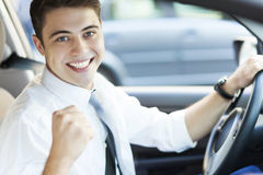 Excited man driving a car. Young man sitting in car Royalty Free Stock Images