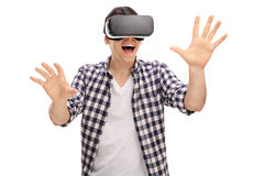 Excited man experiencing virtual reality Royalty Free Stock Photos