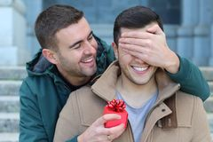 Excited man giving a present to his love one. Excited men giving a present to his love one Stock Photo