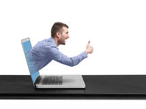 Excited man got out of the laptop Royalty Free Stock Photography