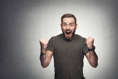 Excited man on grunge background Royalty Free Stock Images