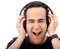 Excited man with headphones Royalty Free Stock Images