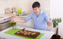 Excited man about healthy food Stock Photography