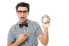 Excited man holding an antique clock Royalty Free Stock Photo
