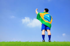 Excited man holding a brazil flag Royalty Free Stock Image