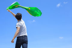 Excited man holding brazil flag Royalty Free Stock Photography