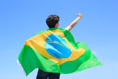Excited man holding brazil flag Stock Photography